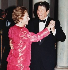 President Ronald Reagan and Prime Minister Margaret Thatcher take a spin around the dance floor in the foyer of the White House during a State Dinner